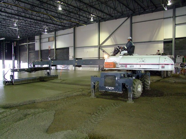 concrete contractor pumping flat, strong, and precise concrete slabs using laser screed equipment