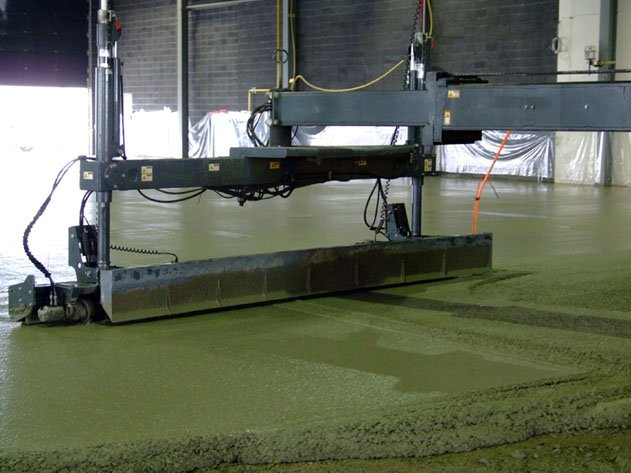 a piece of Dynamic Concrete Pumping laser screed equipment leveling a concrete floor