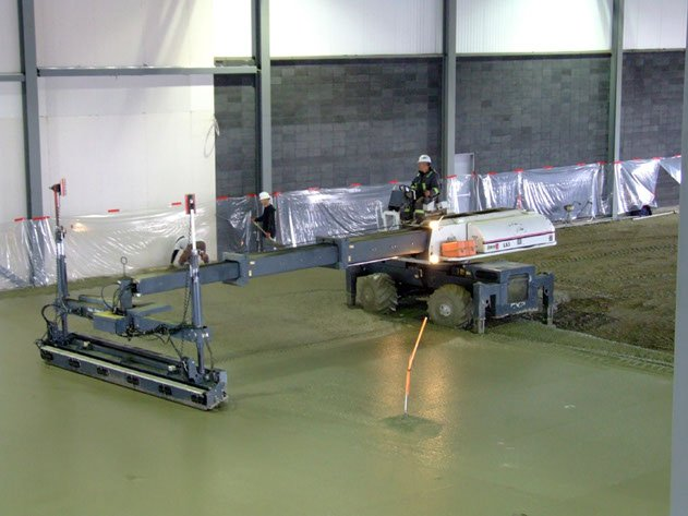 Dynamic Concrete Pumping laser screed contractor leveling a concrete pour using equipment