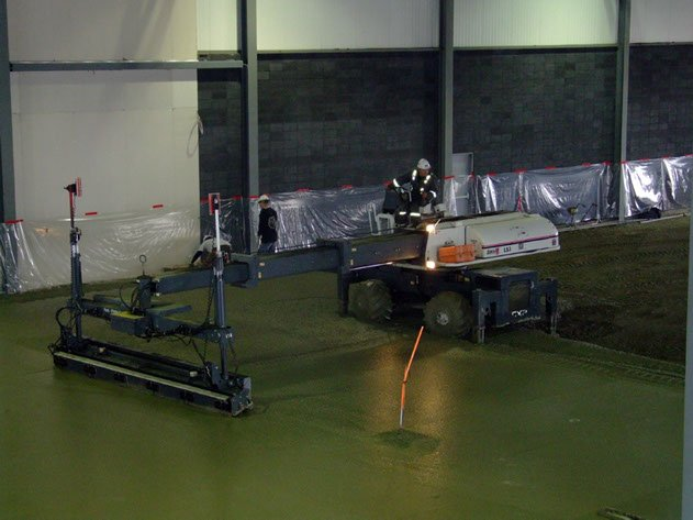 laser screed contractor ensuring a level, strong concrete slab on a project