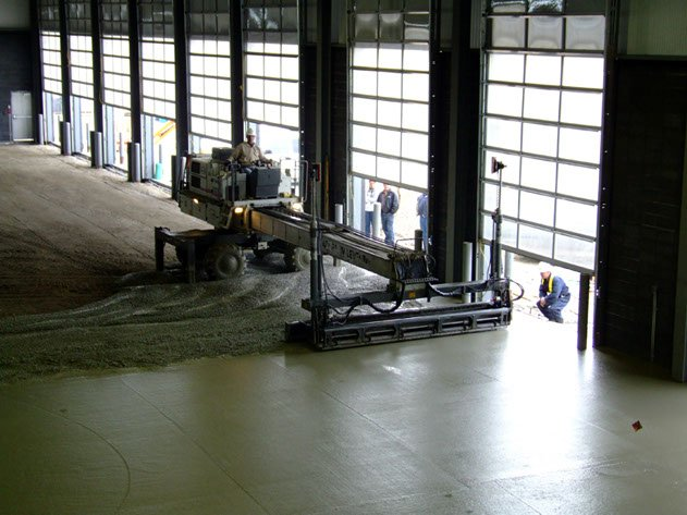 Dynamic Concrete Pumping employee operating a laser screed machine