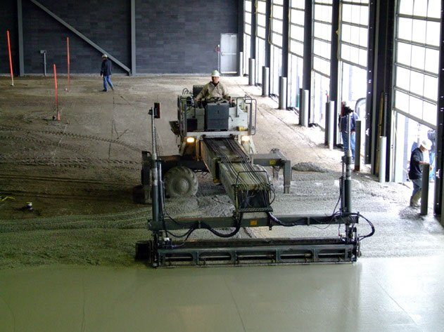 Dynamic Concrete Pumping contractor ensuring a level concrete surface using laser screed equipment