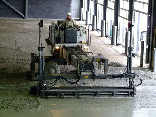 Dynamic Concrete Pumping contractor on a piece of laser screed equipment