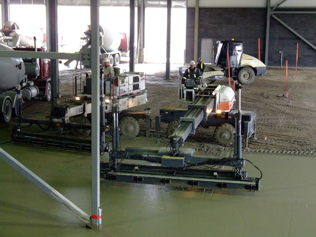 two Dynamic Concrete Pumping laser screed machines working together to ensure flat, precises concrete slabs on a project