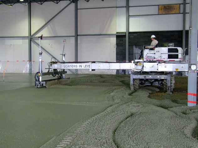 Dynamic Concrete Pumping laser screed equipment at work ensuring level concrete floors on a project