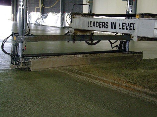 laser screed machine leveling a concrete slab