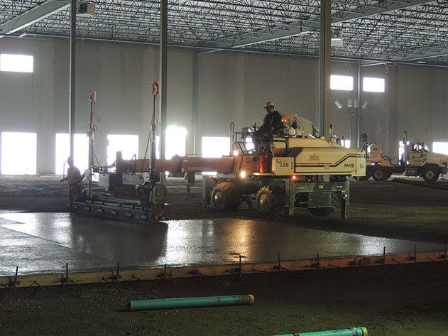 laser screed contractor leveling concrete at a Dynamic Concrete Pumping job site