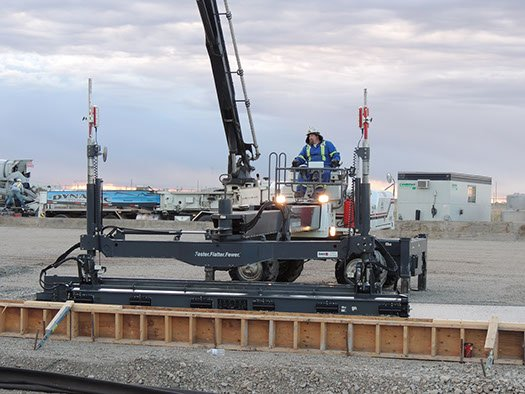 Dynamic Concrete Pumping equipment operator using a piece of laser screed equipment on a project