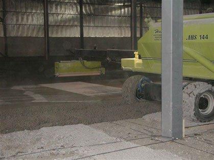 Dynamic Concrete Pumping concrete hardener spreader at work