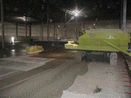 Dynamic Concrete Pumping hardener spreader at work