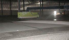 side sprayer on Dynamic Concrete Pumping's hardener spreader at work