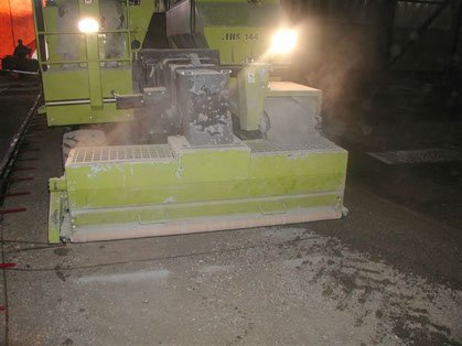 concrete hardener spreader with lights on working
