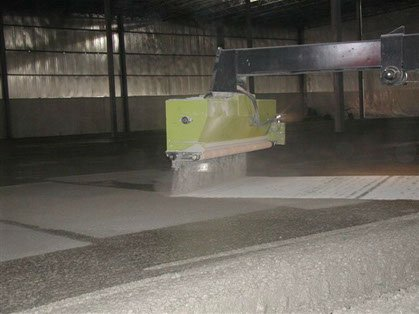 hardener spreader actively spreading concrete at a job site