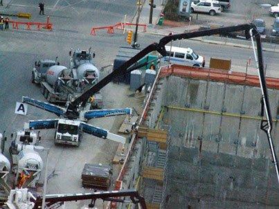Dynamic Concrete Pumping 55-M concrete boom pump in use at a job site