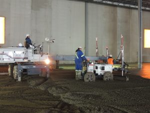 a Dynamic Concrete Pumping crew working on a superflat floors project