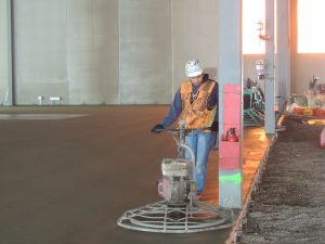 professional and reliable concrete finishing contractor working on a Dynamic Concrete Pumping project