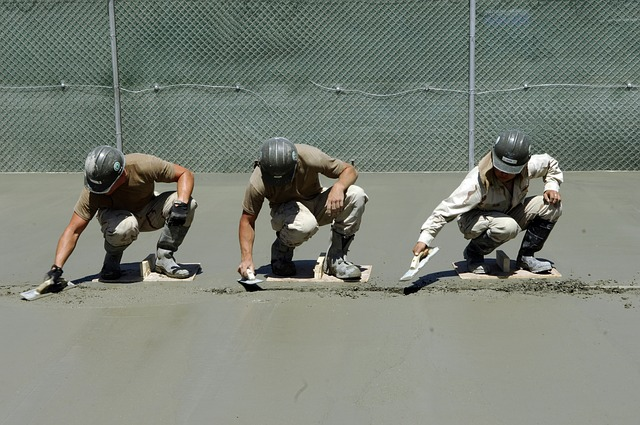 Workers Smoothing Concrete Before it Dries