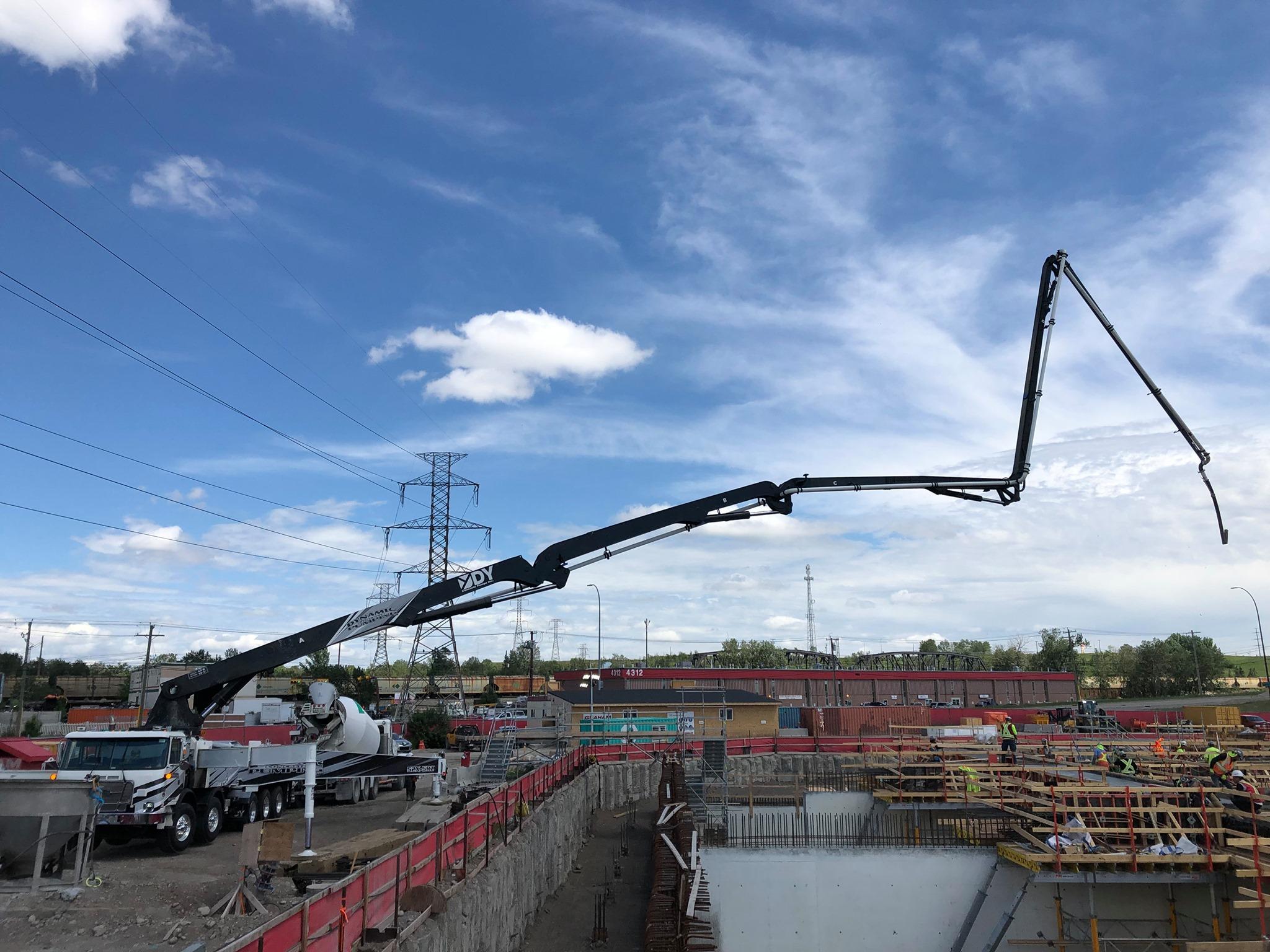 Dynamic Concrete Pumping utilizing their 52-meter concrete boom pump on a job