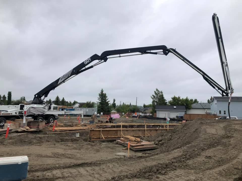 Dynamic Concrete Pumping using their 52-M concrete boom pump at a job site