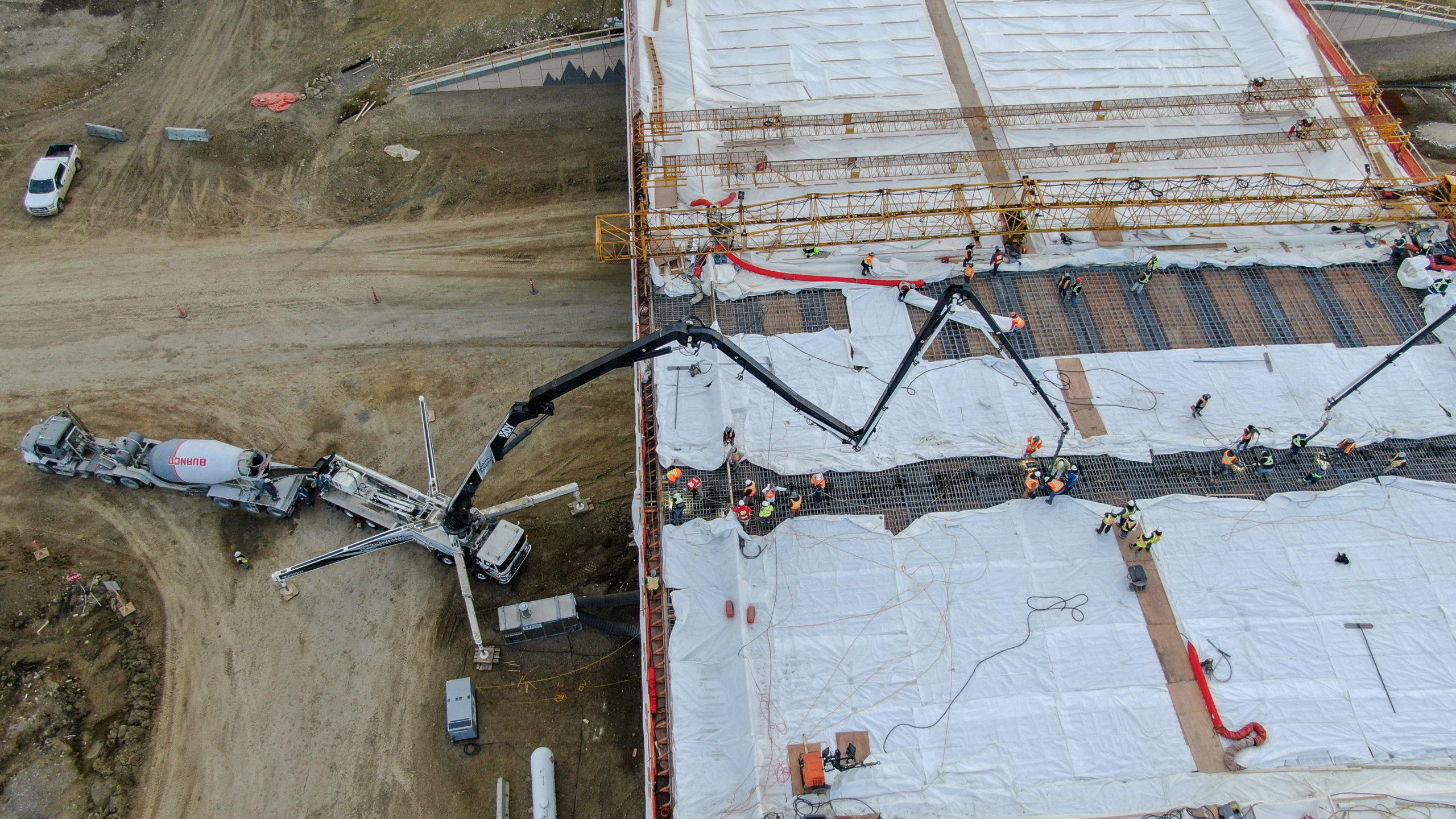 Dynamic Concrete Pumping using a boom pump to add concrete to the structure at the SW Calgary Ring Road job site