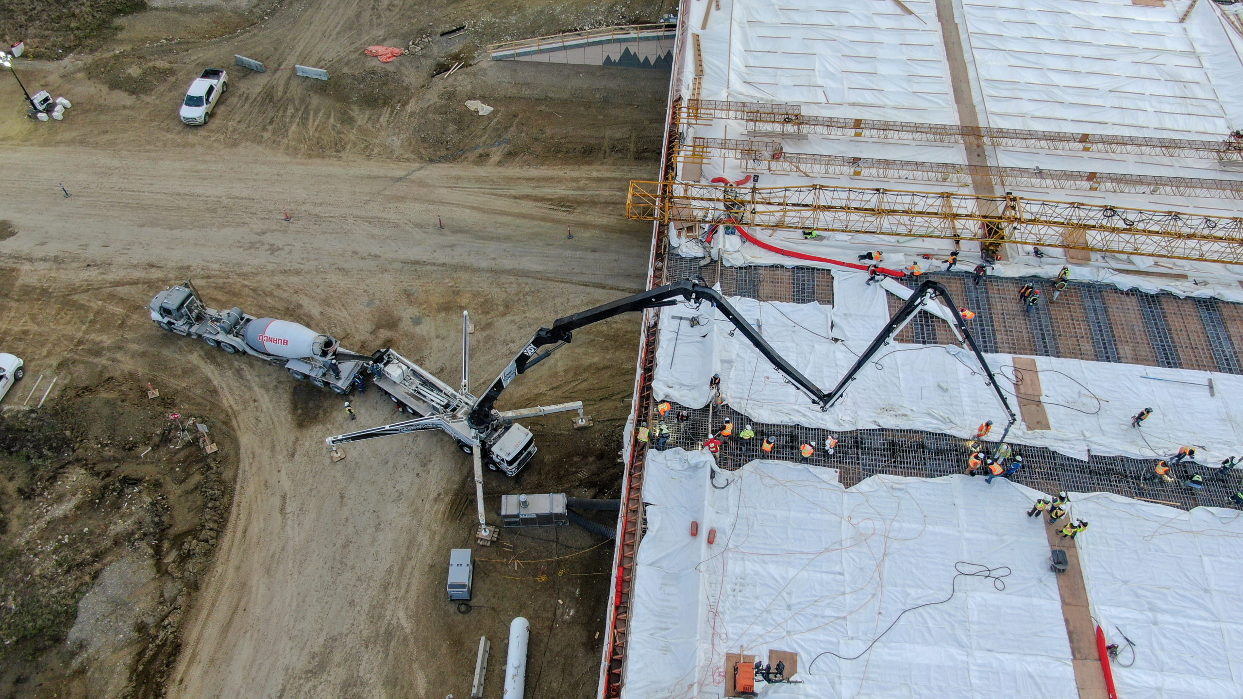 Dynamic Concrete Pumping using a boom pump to add concrete to the structure at the SW Calgary Ring Road