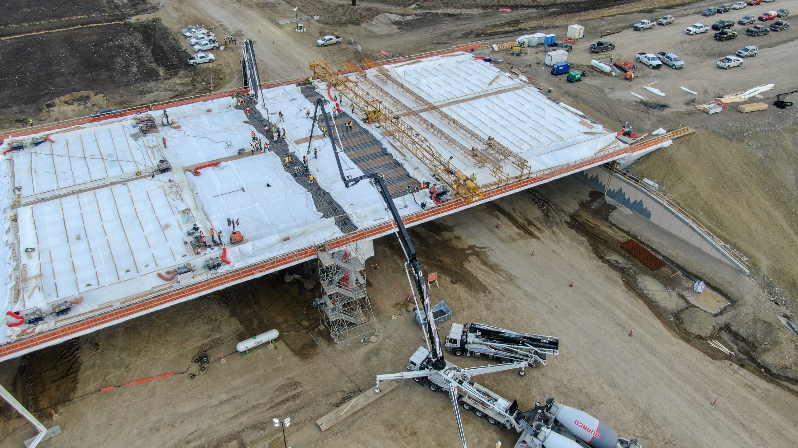 large Dynamic Concrete Pumping boom pump working on the SW Calgary Ring Road job