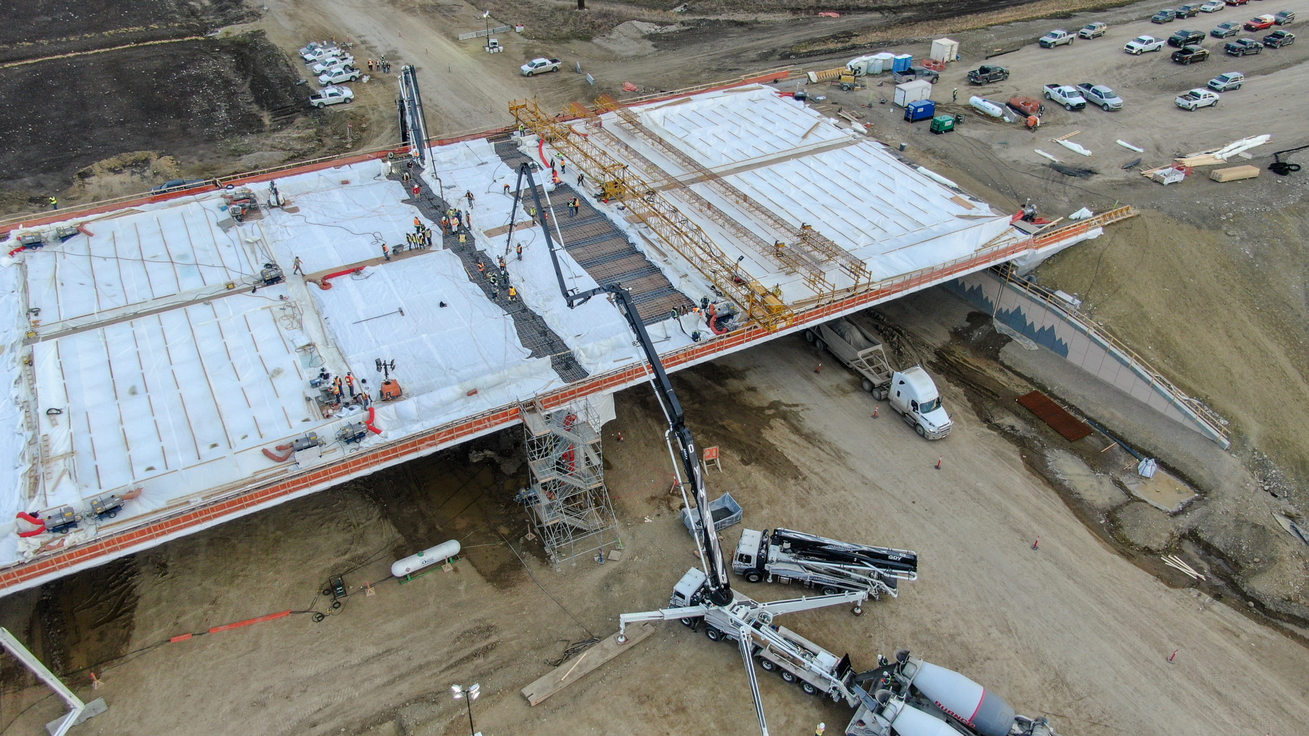 side view of Dynamic Concrete Pumping working on the SW Calgary Ring Road job
