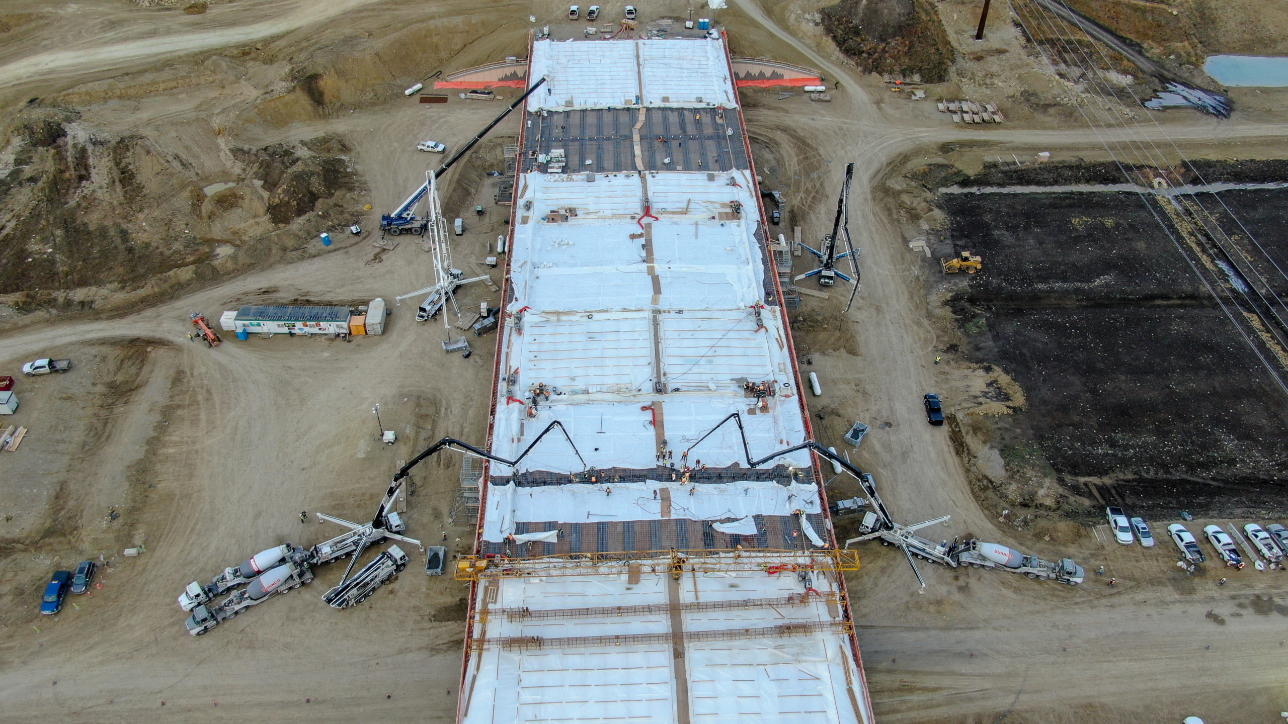 Dynamic Concrete Pumping boom pumps working on the SW Calgary Ring Road project