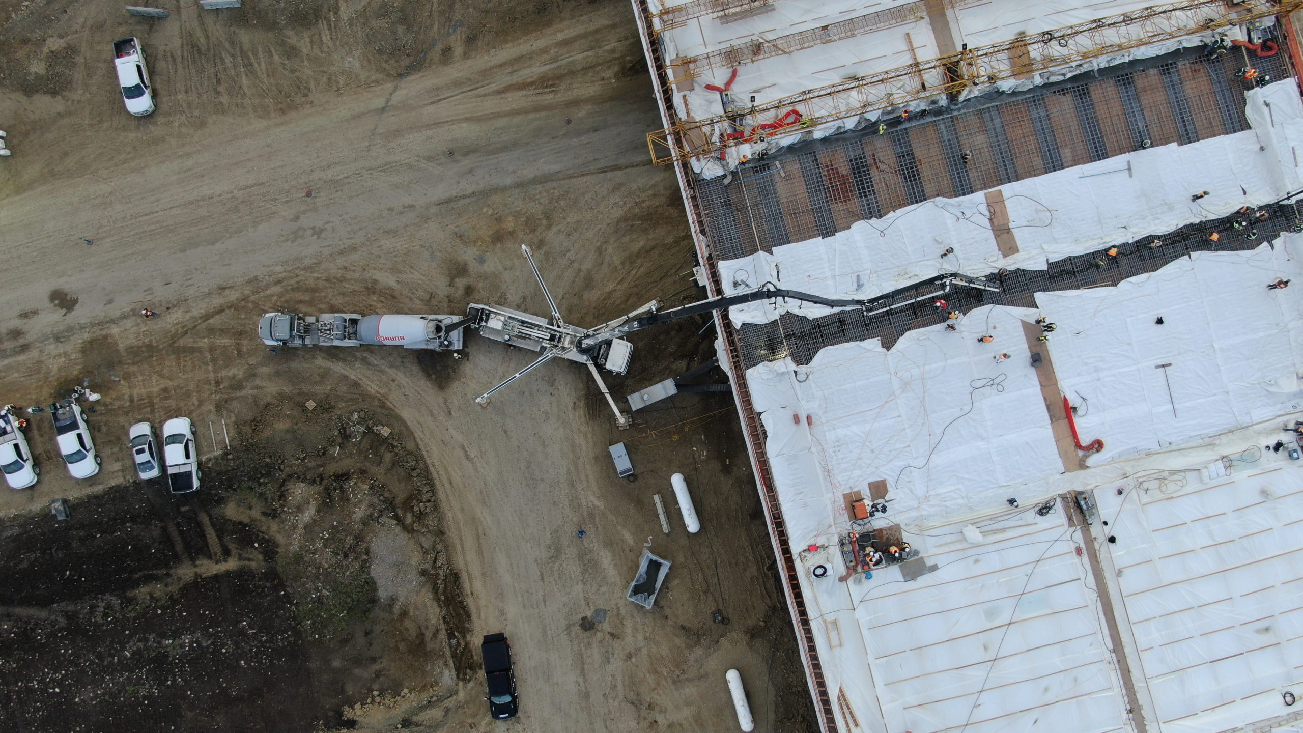 a Dynamic Concrete Pumping boom pump adding concrete to the SW Calgary Ring Road