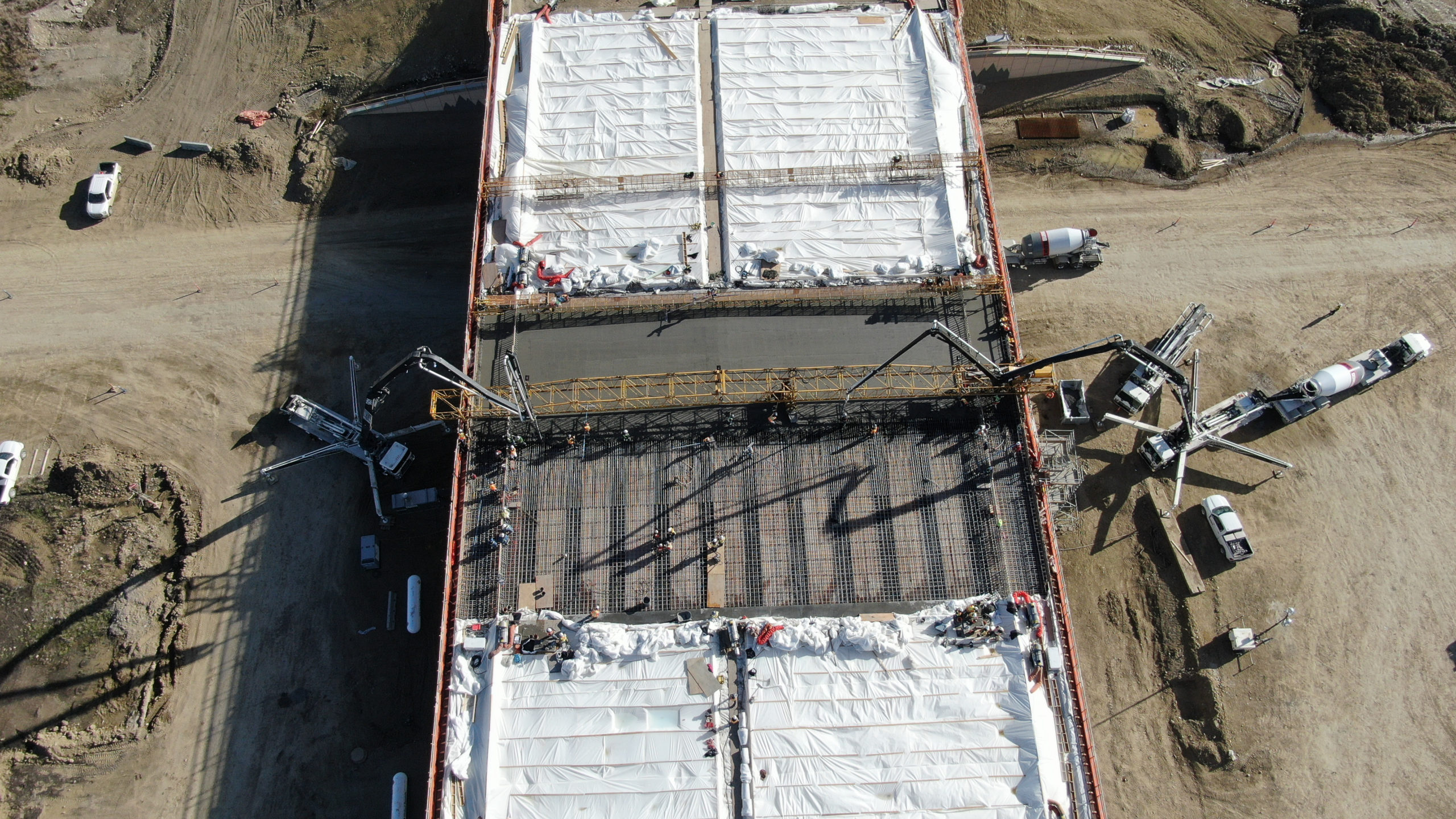 concrete being added to a structure at the SW Calgary Ring Road job using boom pumps