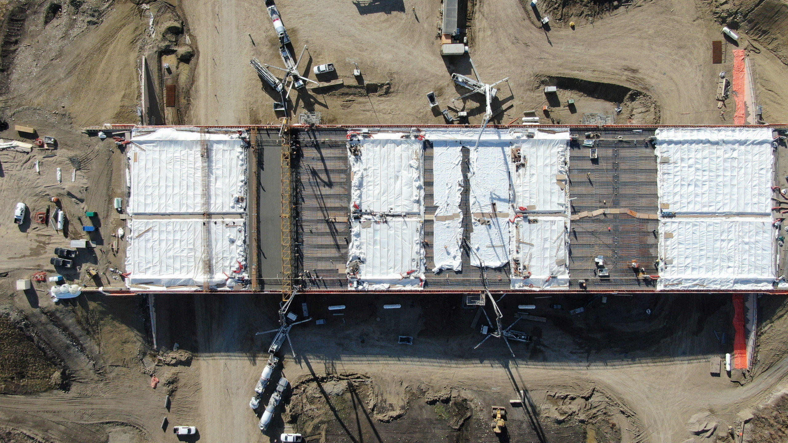 view of Dynamic Concrete Pumping working on the SW Calgary Ring Road from above