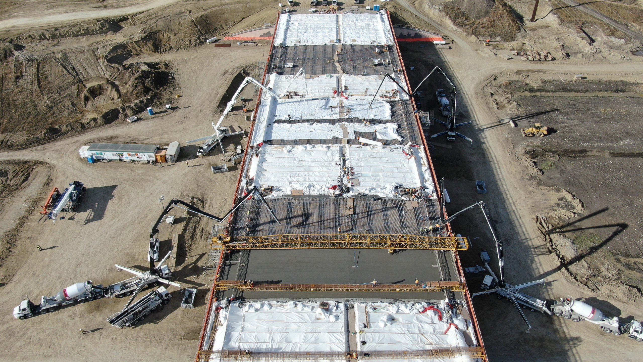 Dynamic Concrete Pumping utilizing concrete boom pumps on the SW Calgary Ring Road project