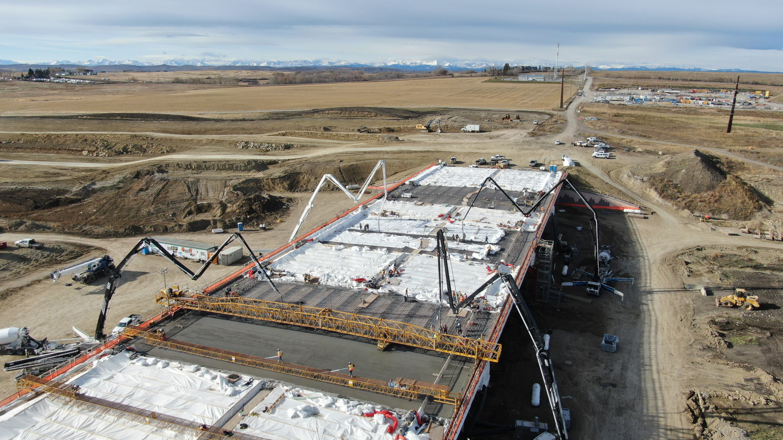 four Dynamic Concrete Pumping pumps adding concrete to the SW Calgary Ring Road project