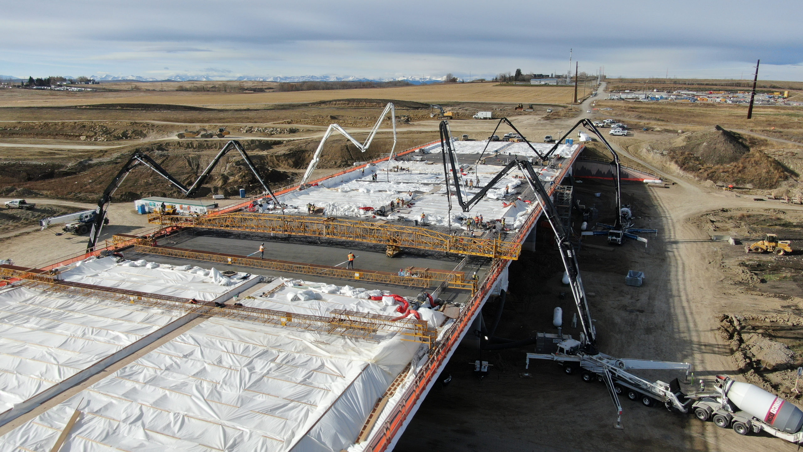 four Dynamic Concrete Pumping boom pumps working on the SW Calgary Ring Road project