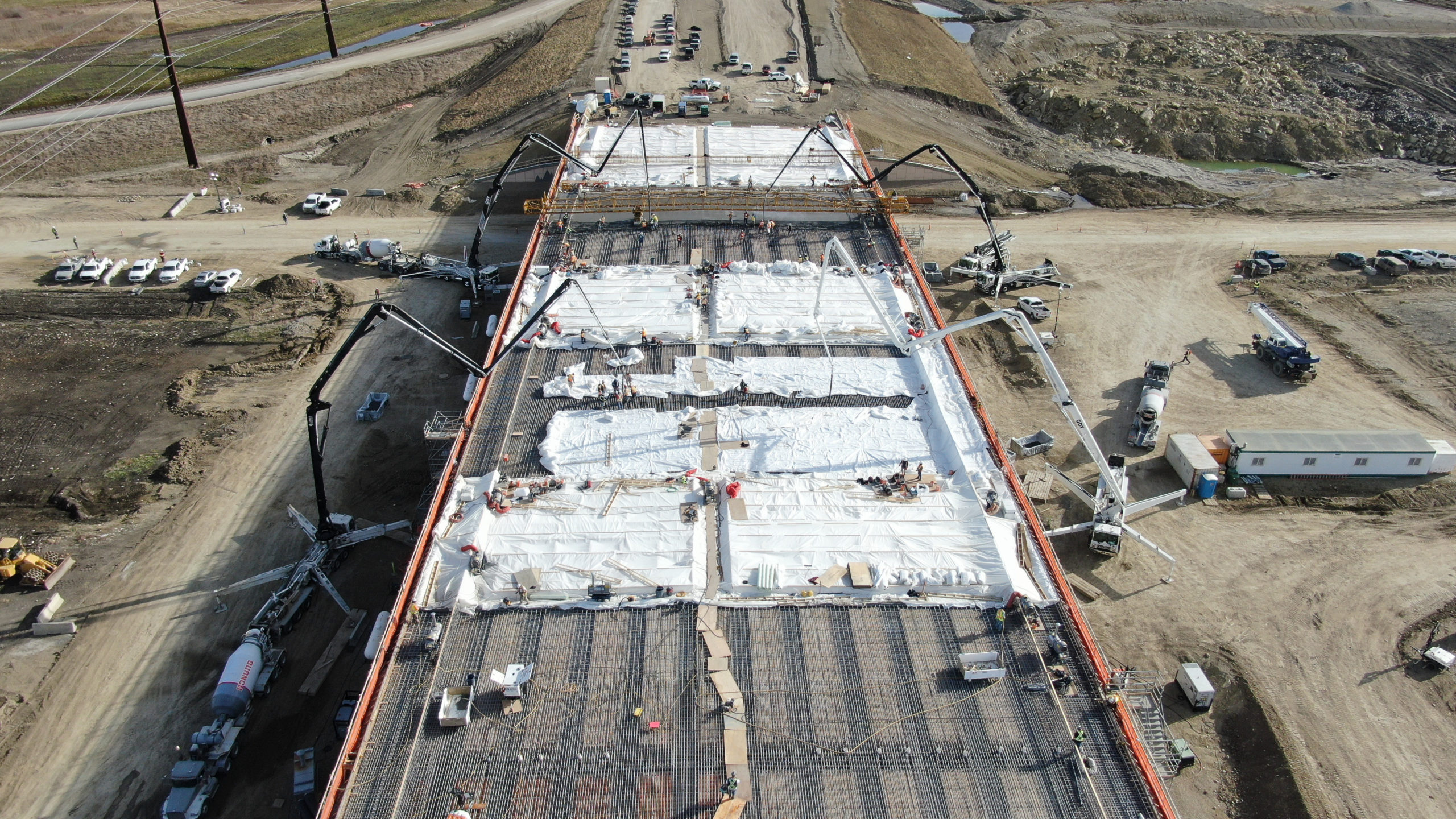 beginning of pumping concrete on the bridge at the SW Calgary Ring Road