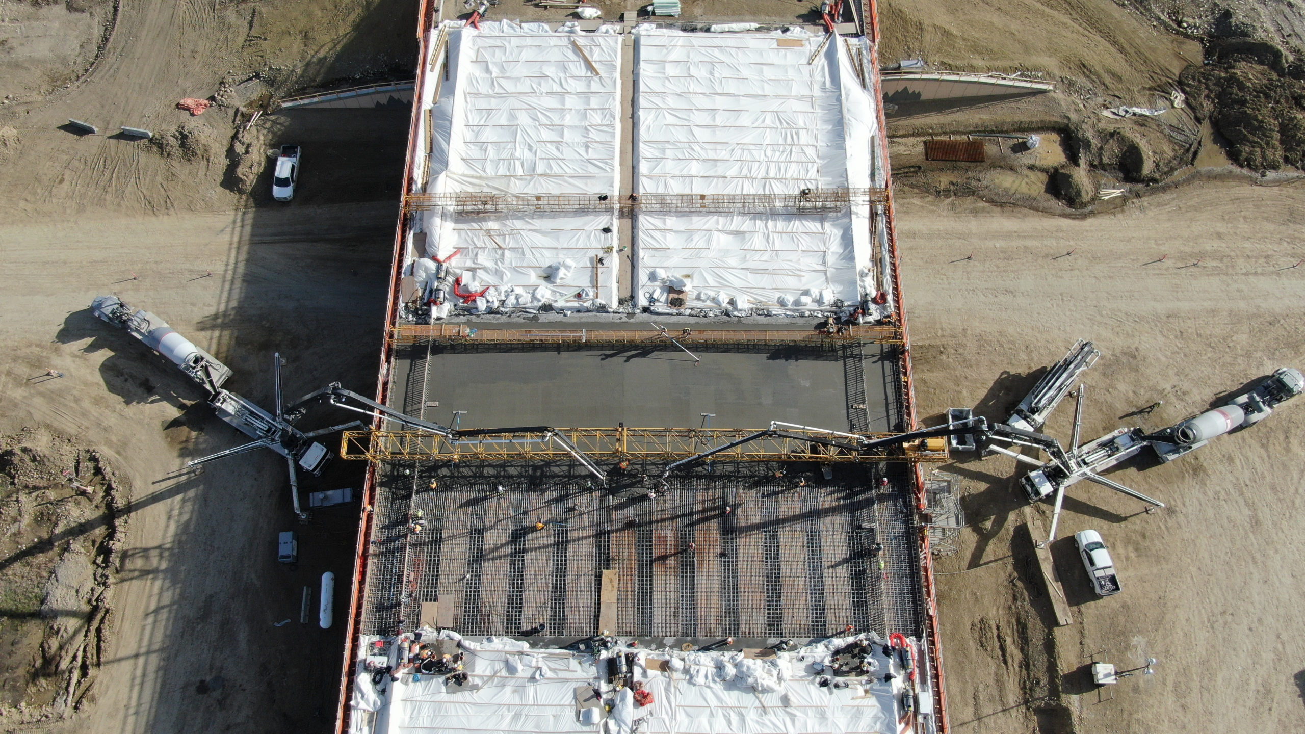 overhead view of two concrete pumps pumping concrete at the SW Calgary Ring Road job site