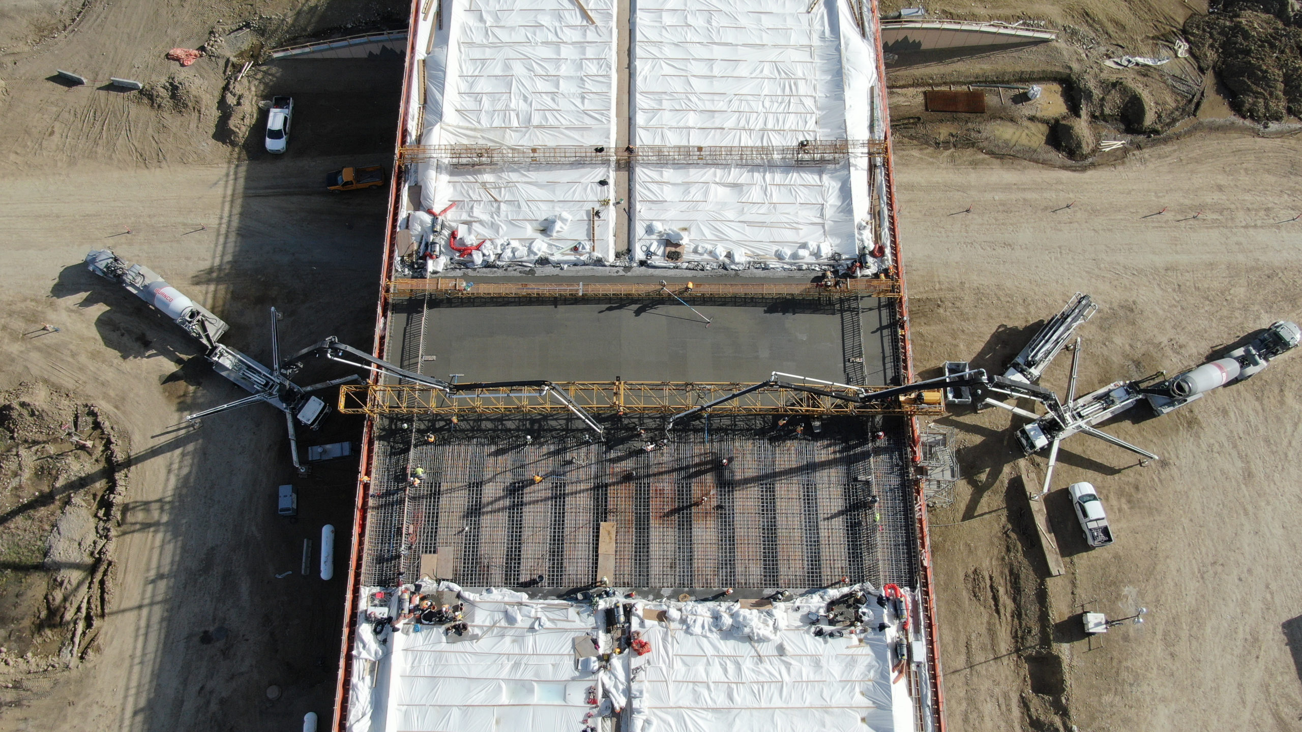 Dynamic Concrete Pumping using two concrete boom pumps to complete the SW Calgary Ring Road project