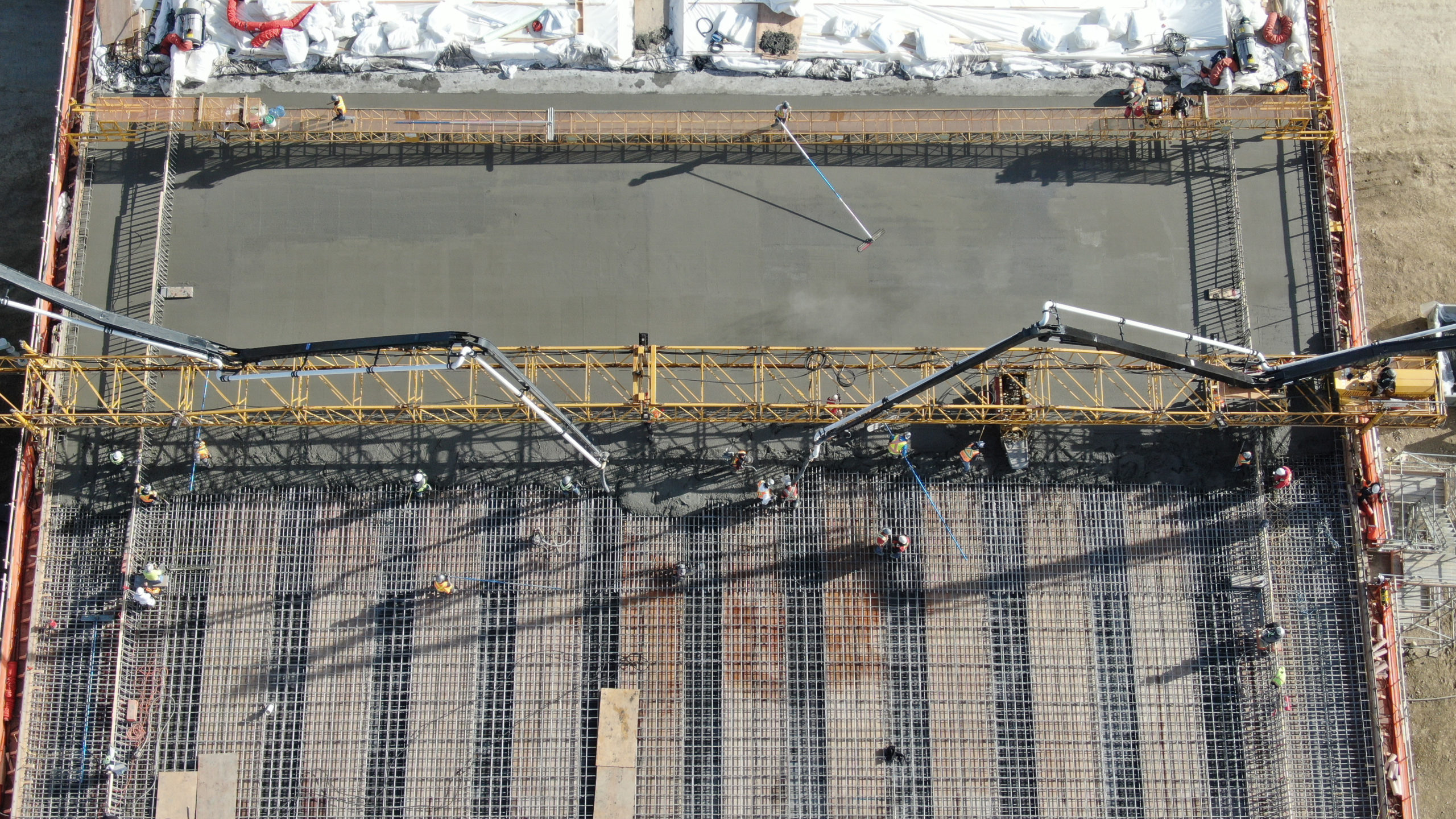 view from above of Dynamic Concrete Pumping contractors pumping concrete at the SW Calgary Ring Road job