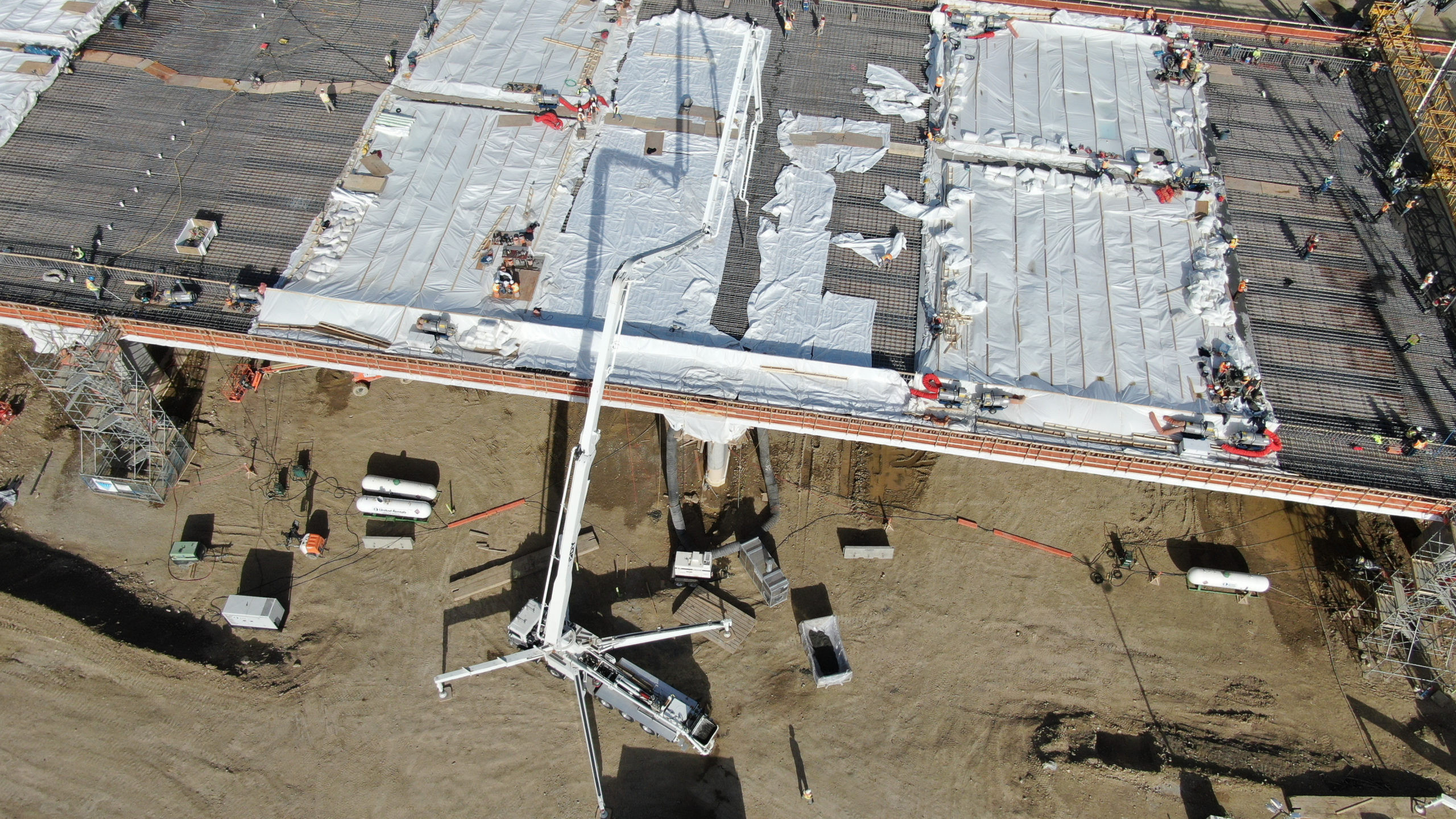 using a Dynamic Concrete Pumping boom pump to add concrete to a structure on the SW Calgary Ring Road project