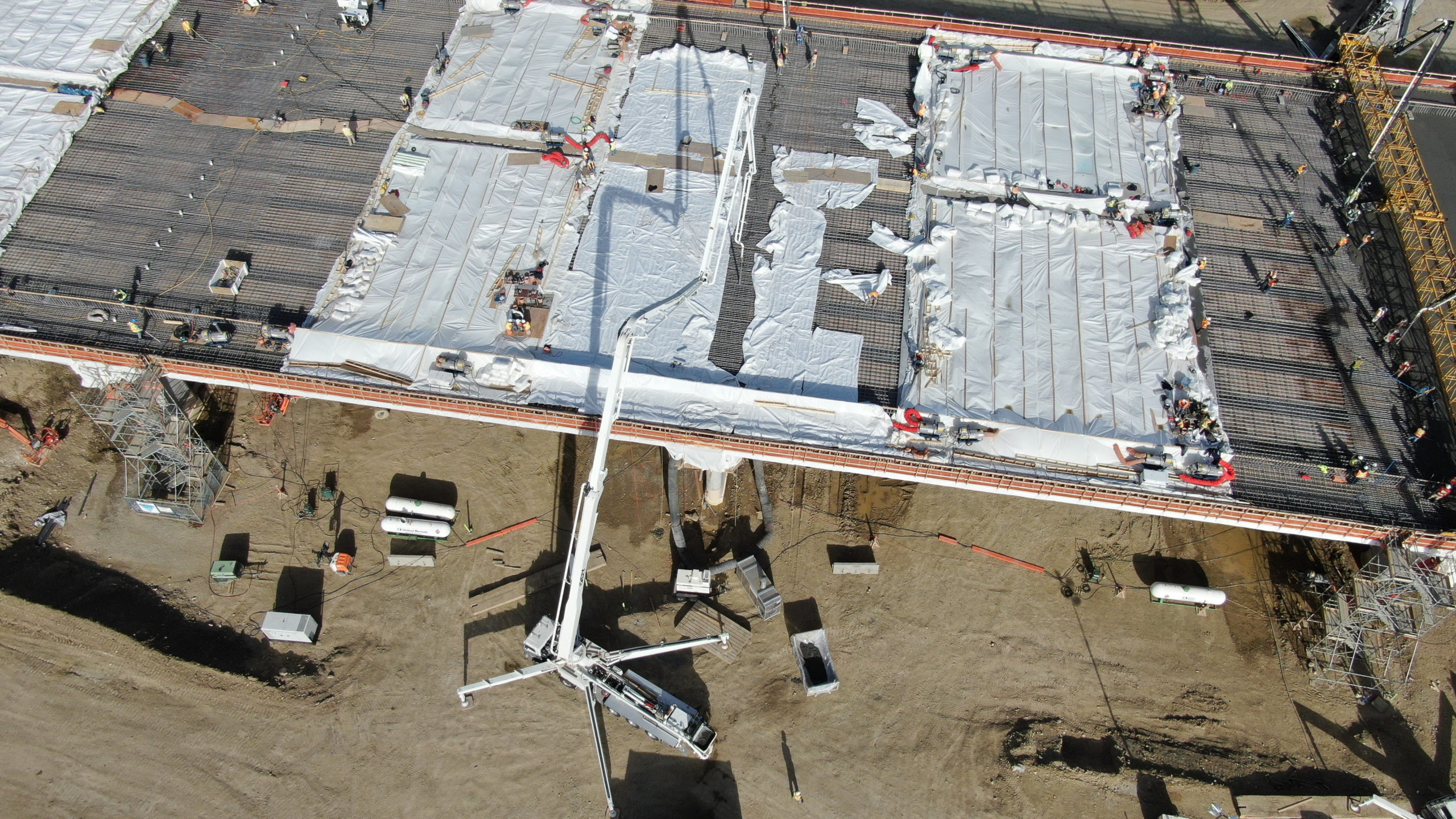 Dynamic Concrete Pumping crew working on the SW Calgary Ring Road project
