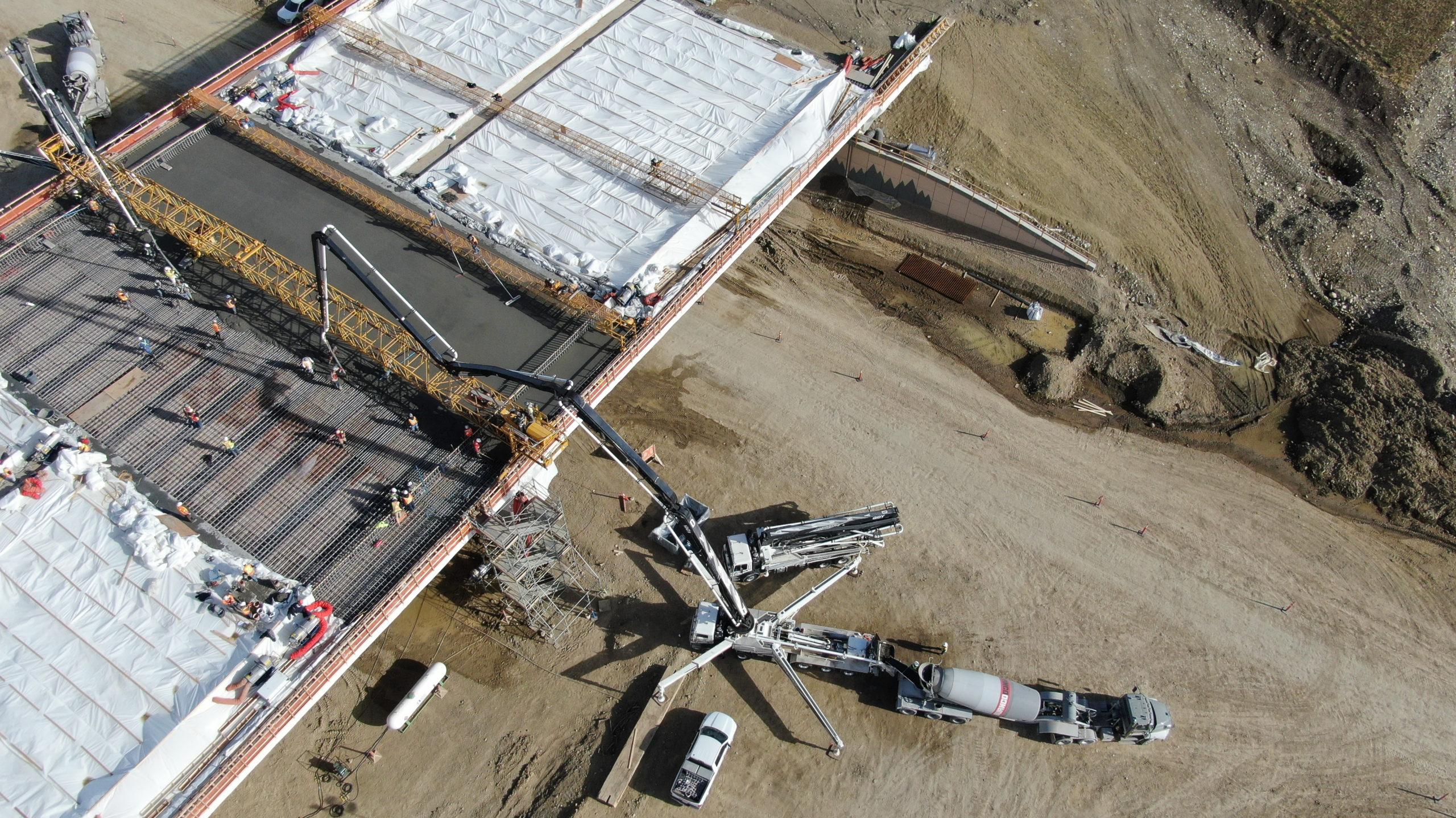 a Dynamic Concrete Pumping boom pump at work on the SW Calgary Ring Road project