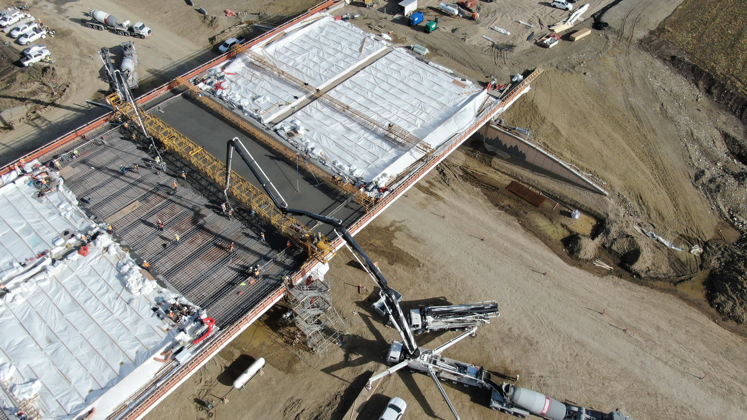 concrete boom pumps at work on the SW Calgary Ring Road project
