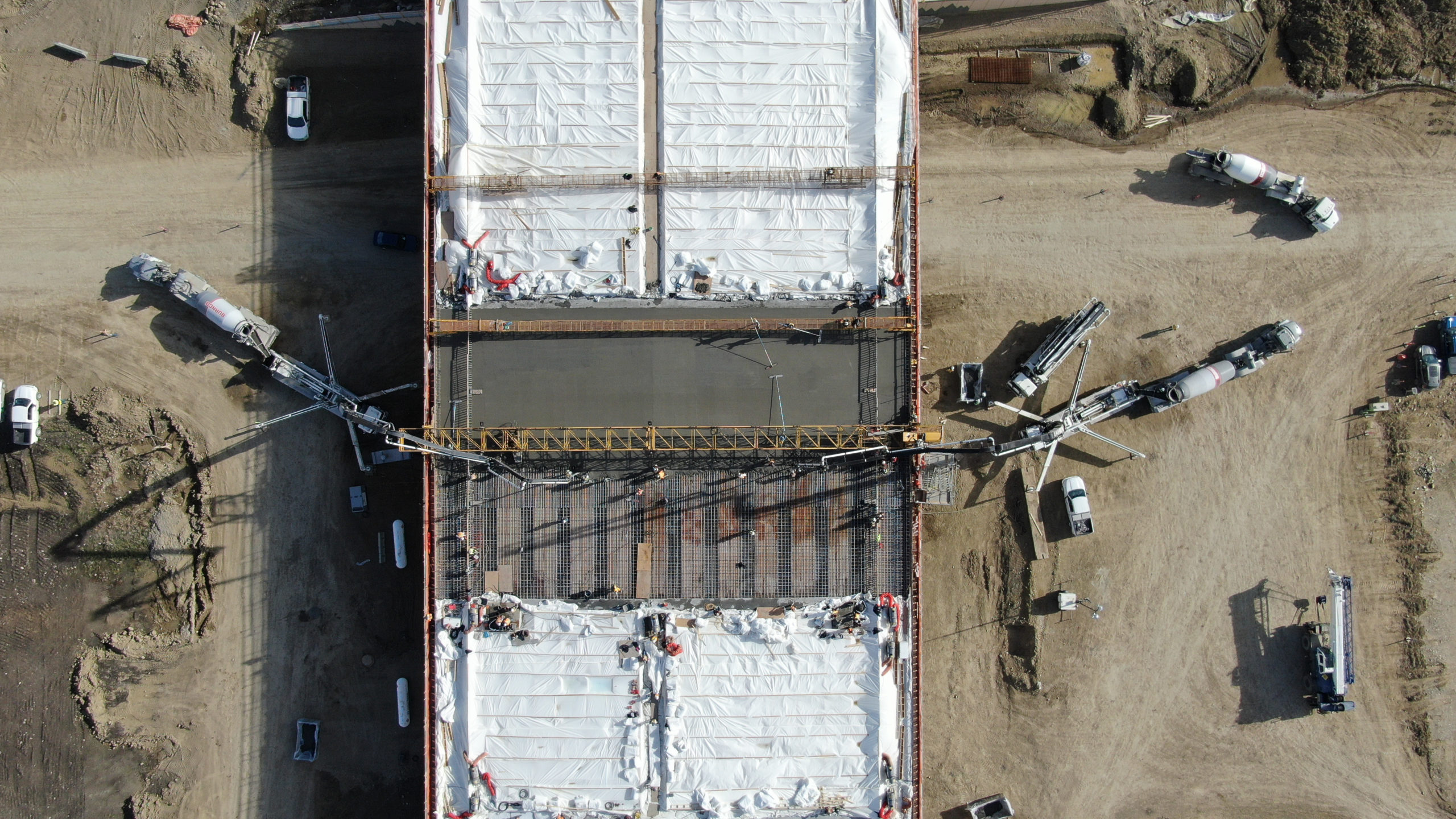 concrete being pumped onto the bridge of the SW Calgary Ring Road project