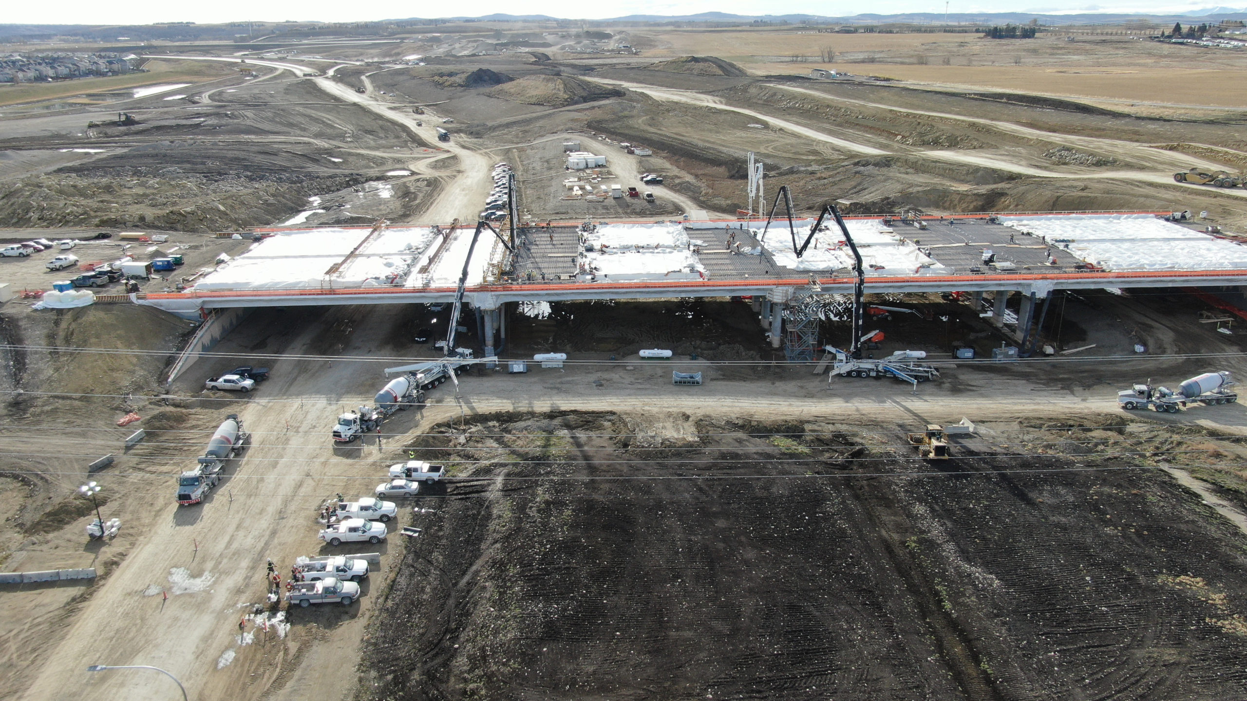 Dynamic Concrete Pumping adding concrete to the bridge of the SW Calgary Ring Road