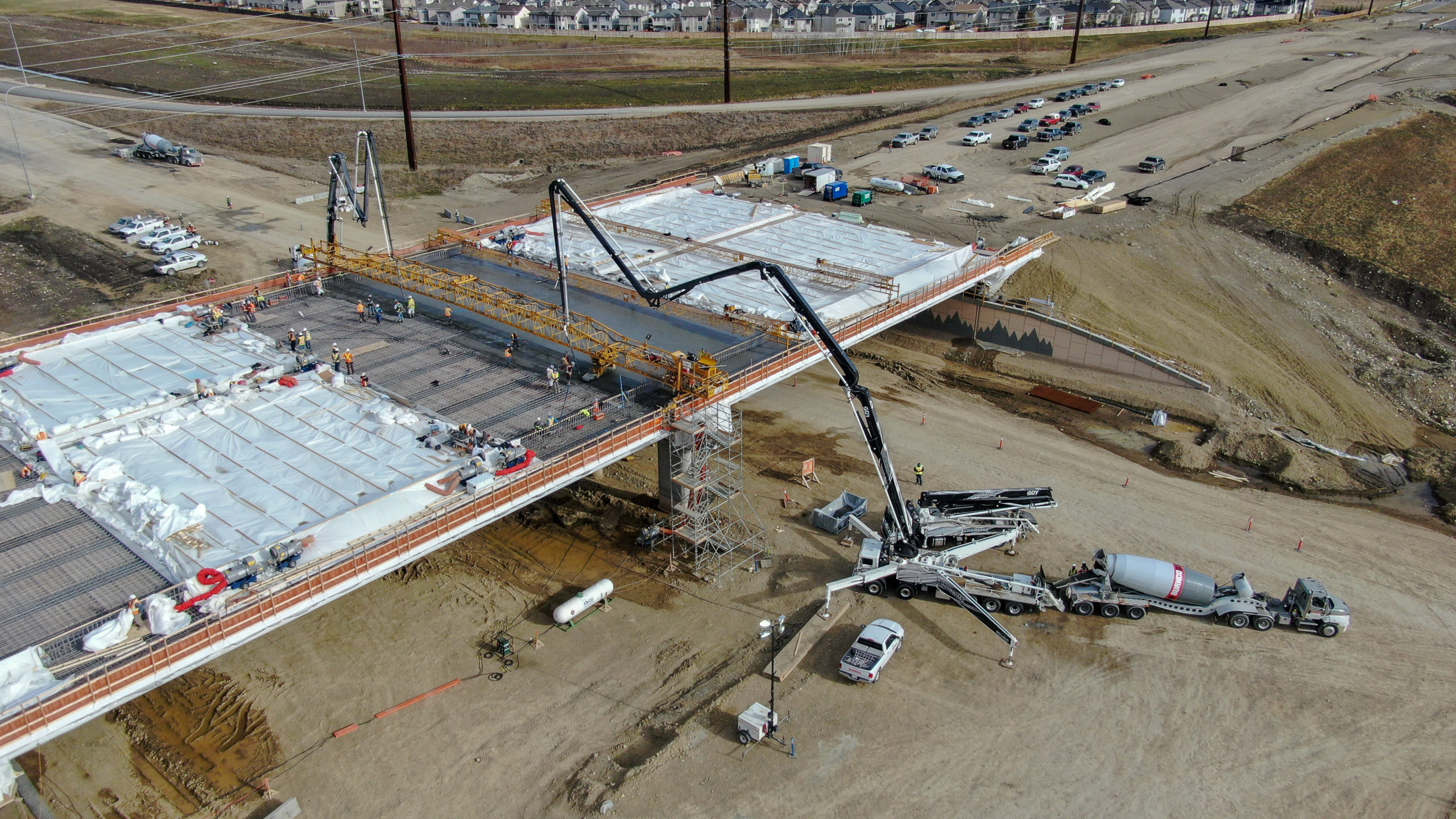 two concrete boom pumps being used to pump concrete at the SW Calgary Ring Road job site