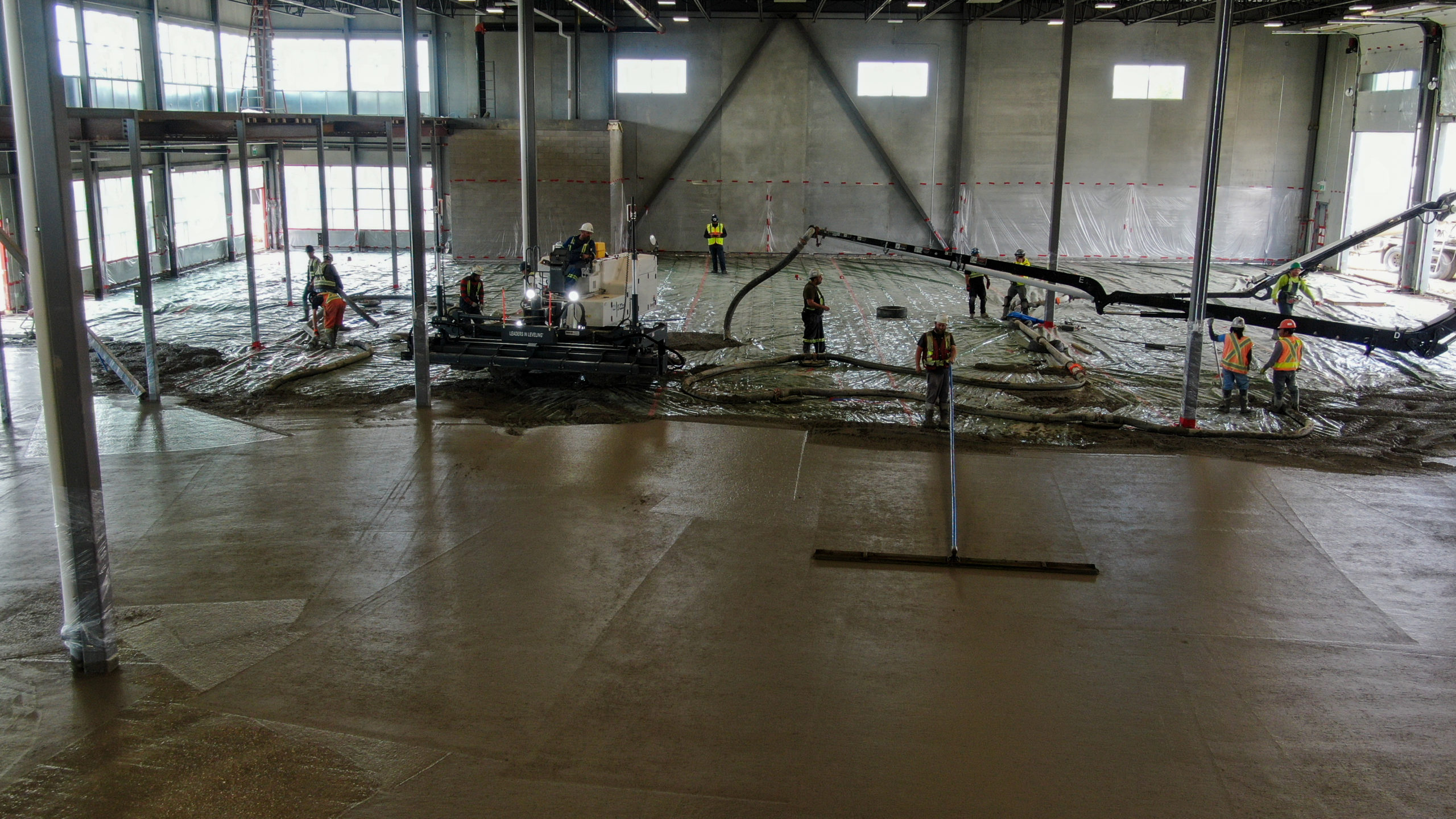 group of Dynamic Concrete Pumping contractors completing a concrete floor at the HF11 industrial condo development project