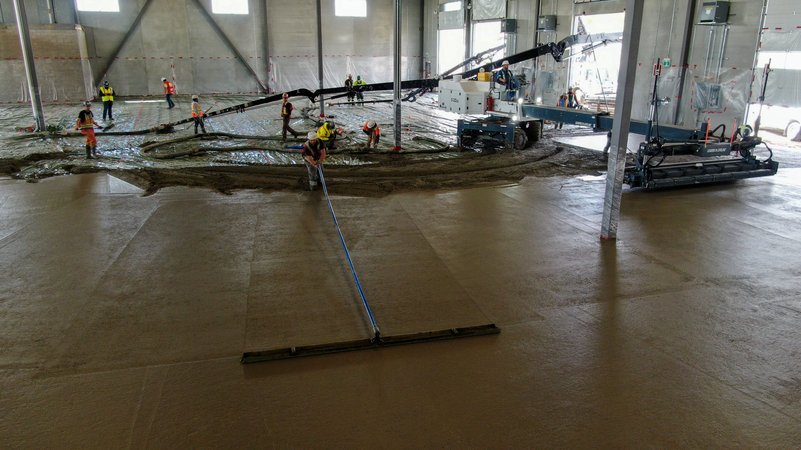 concrete contractor from Dynamic Concrete Pumping ensuring the HF11 industrial condo development has super flat concrete floors