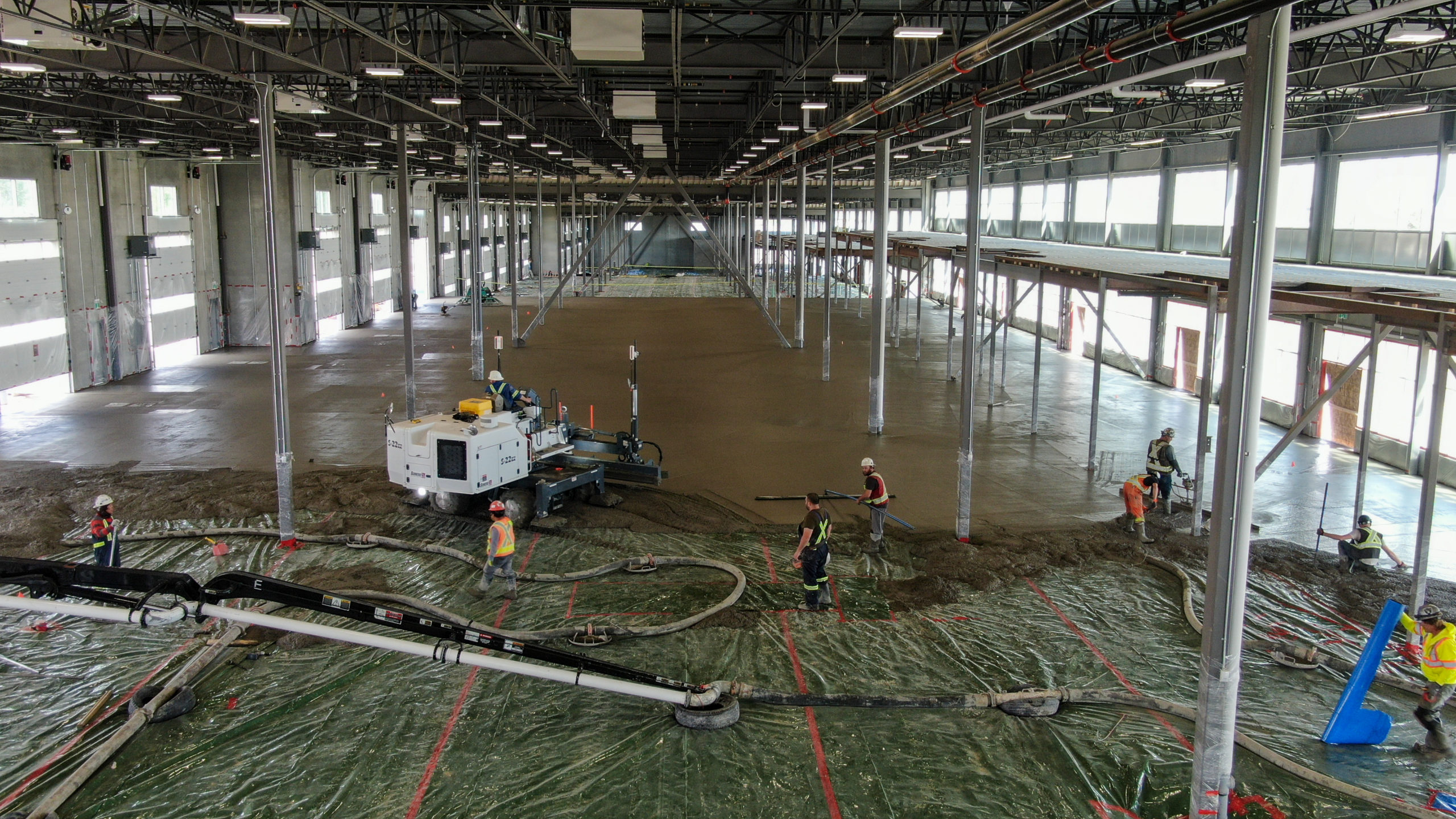 flat concrete floors being placed inside the HF11 industrial condo development project