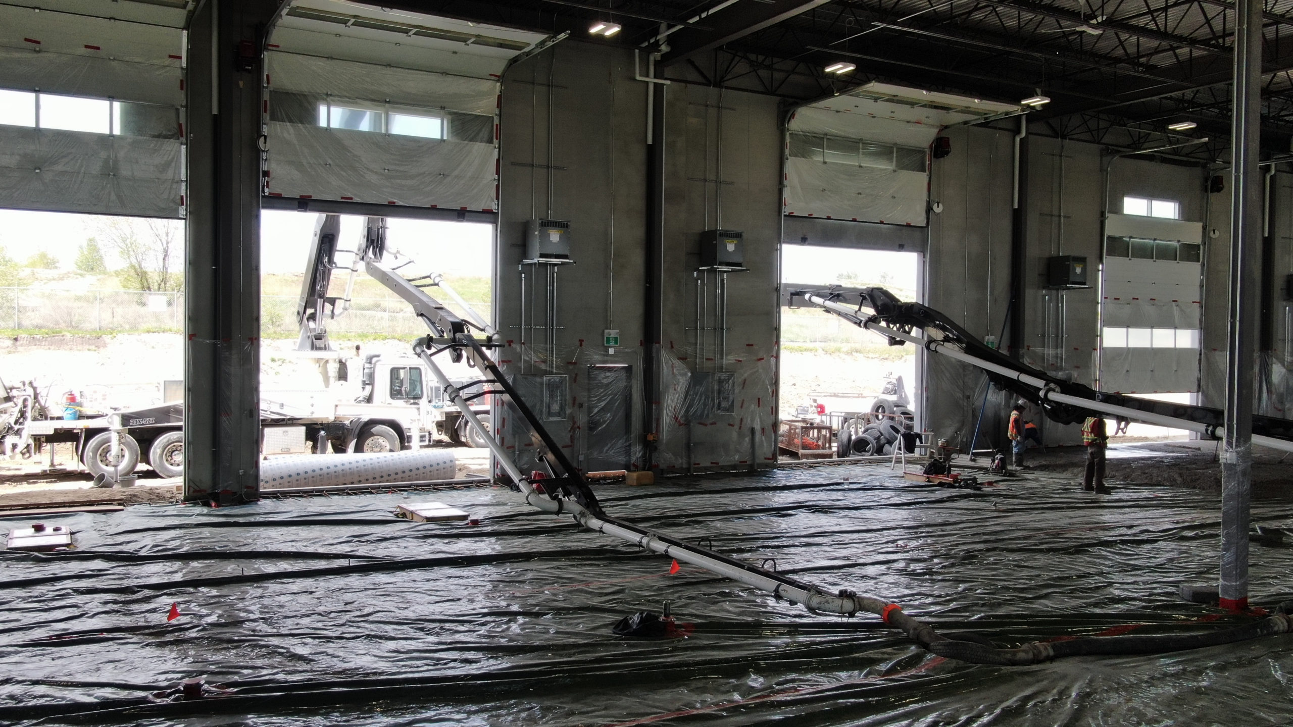 concrete boom pumps pumping concrete into the HF11 industrial condo development