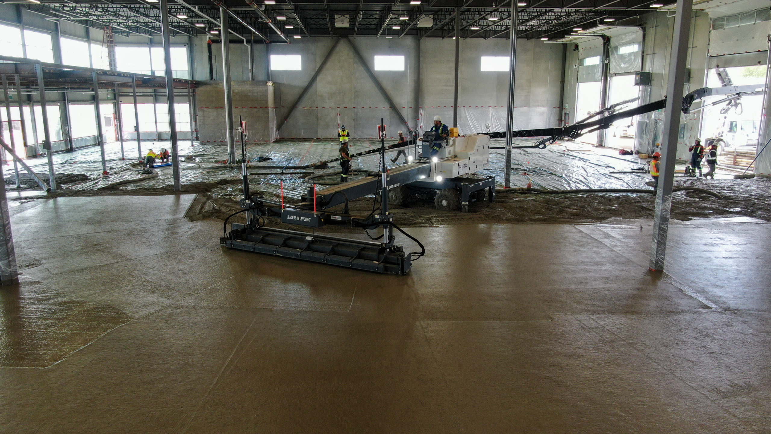 Dynamic Concrete Pumping contractors working on the floors of the HF11 industrial condo development job